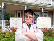 2020 Van Wert High School graduate Jared Weiss poses with his high school diploma and his college diploma. Weiss earned his associate's of science from Rhodes State College while in high school.