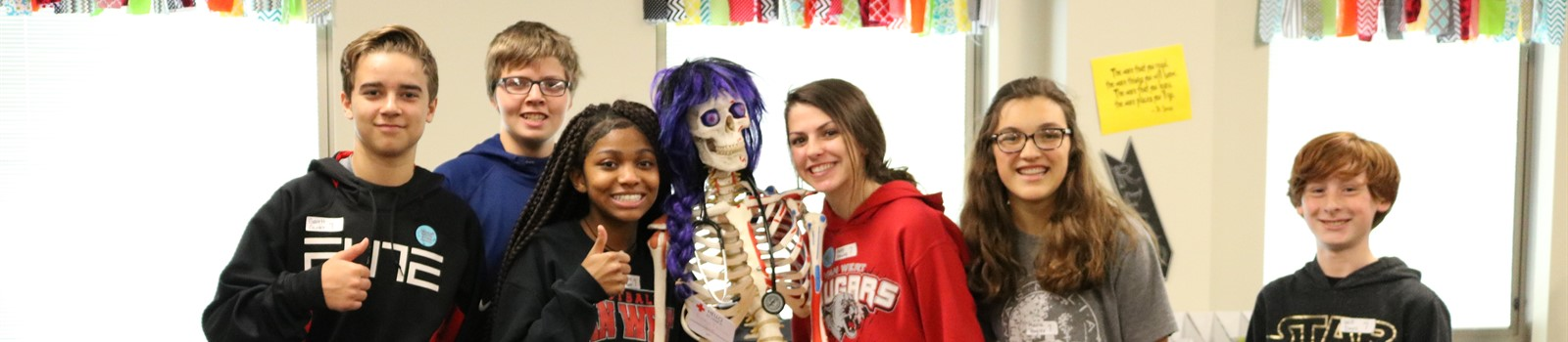 8th grade students post with skeleton during their field trip to Vantage