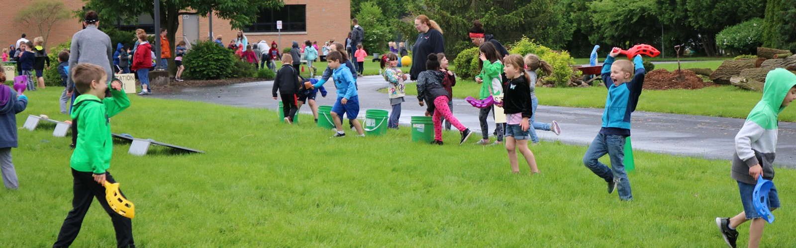 Students participating in various stations during field day