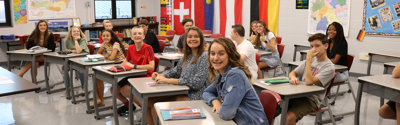High school students gather in the German classroom on the first day of school