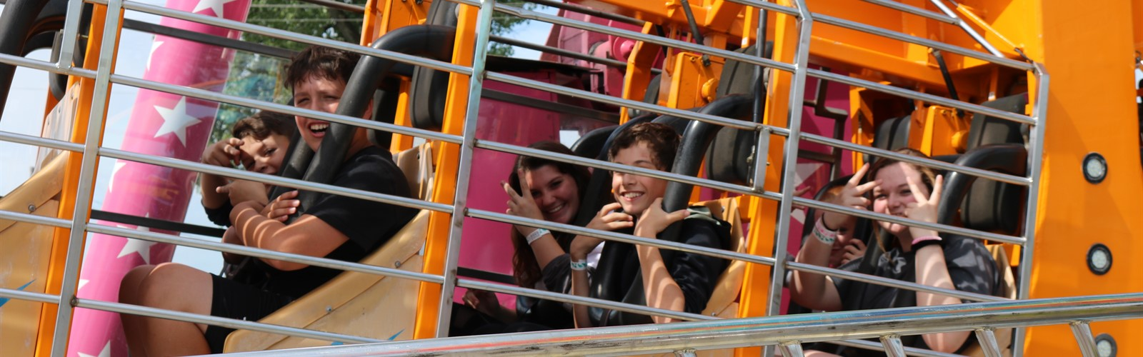 7th grade students riding a ride at the fair