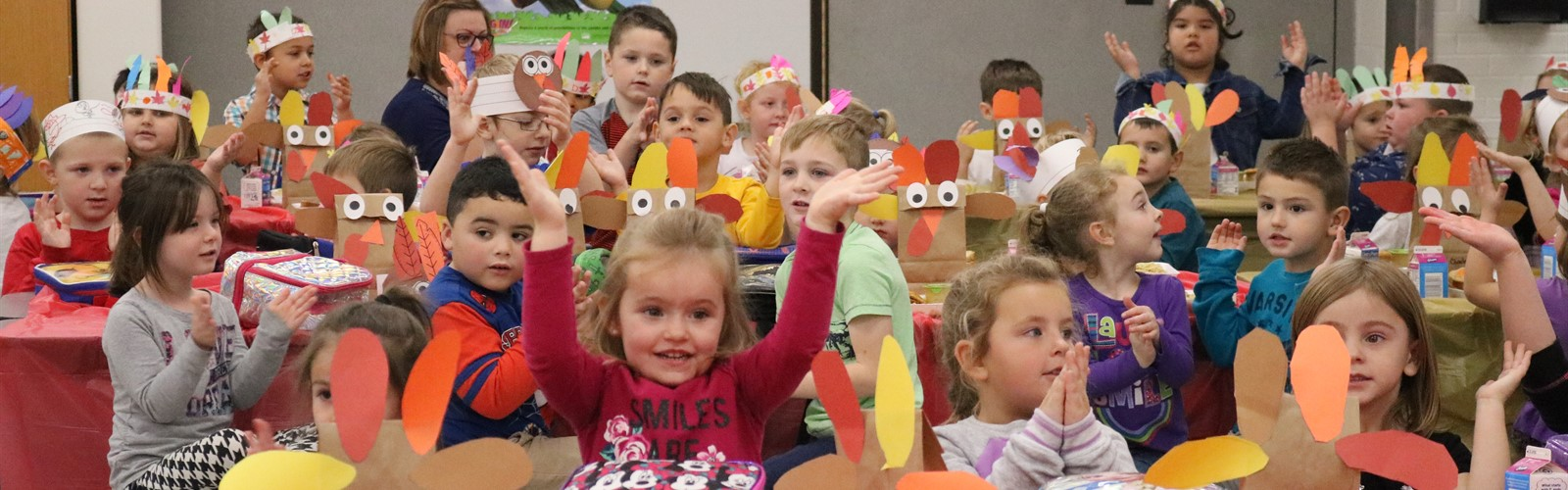 Students sing songs during their Thanksgiving feast