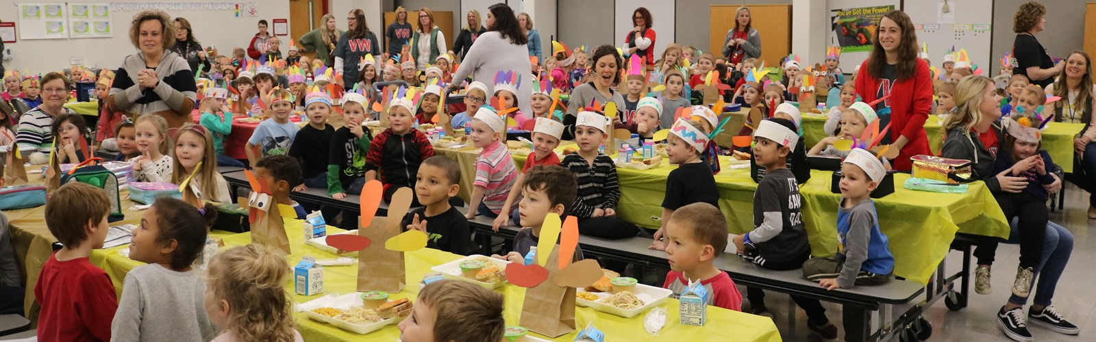 Preschool and Kindergarten students share lunch together for their Thanksgiving feast