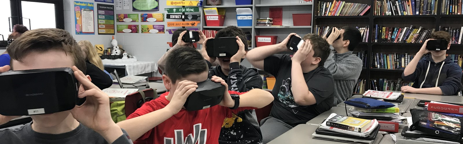 7th grade students using VR goggles during class