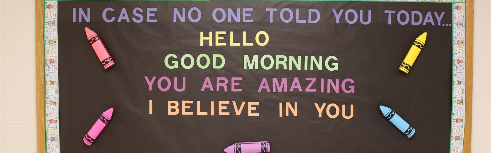 "Bulletin board saying, ""In case no one told you today...hello, good morning, you are amazing, I believe in you."""