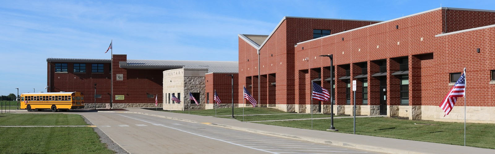 Flags flying in front of Van Wert Elementary School