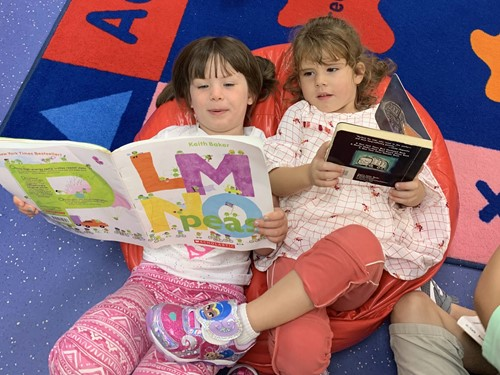 Students read a book together at the ECC