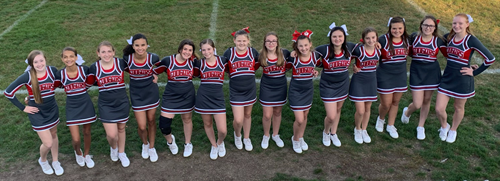 Middle school cheerleaders pose together