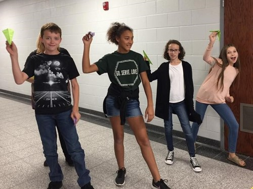 Students get ready to launch their paper airplanes in History Club