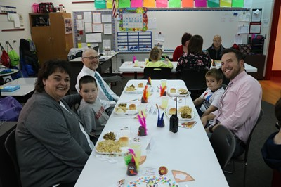 Staff members enjoyed a Thanksgiving feast with some of Miss Dunlap's students