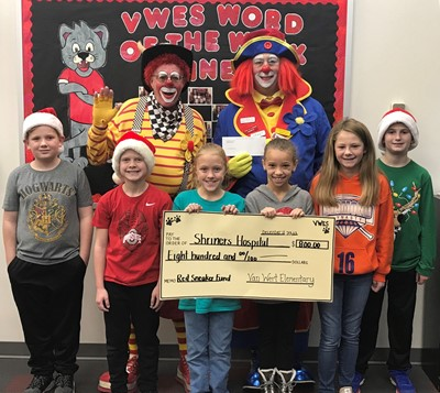 Students donated $800 to the Shriners clowns